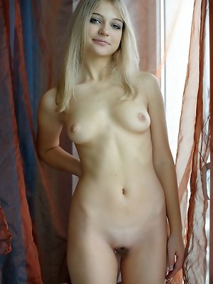 Youthful Natja displays her naked, slender body with small puffy nips