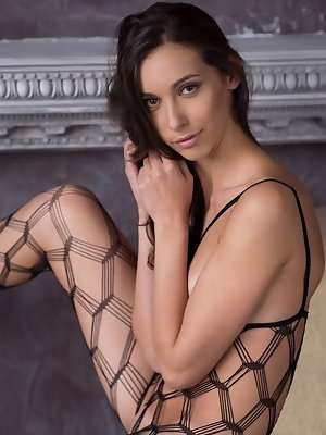 The intricate weave on Magali A's body net lingerie hugs her slender body perfectly